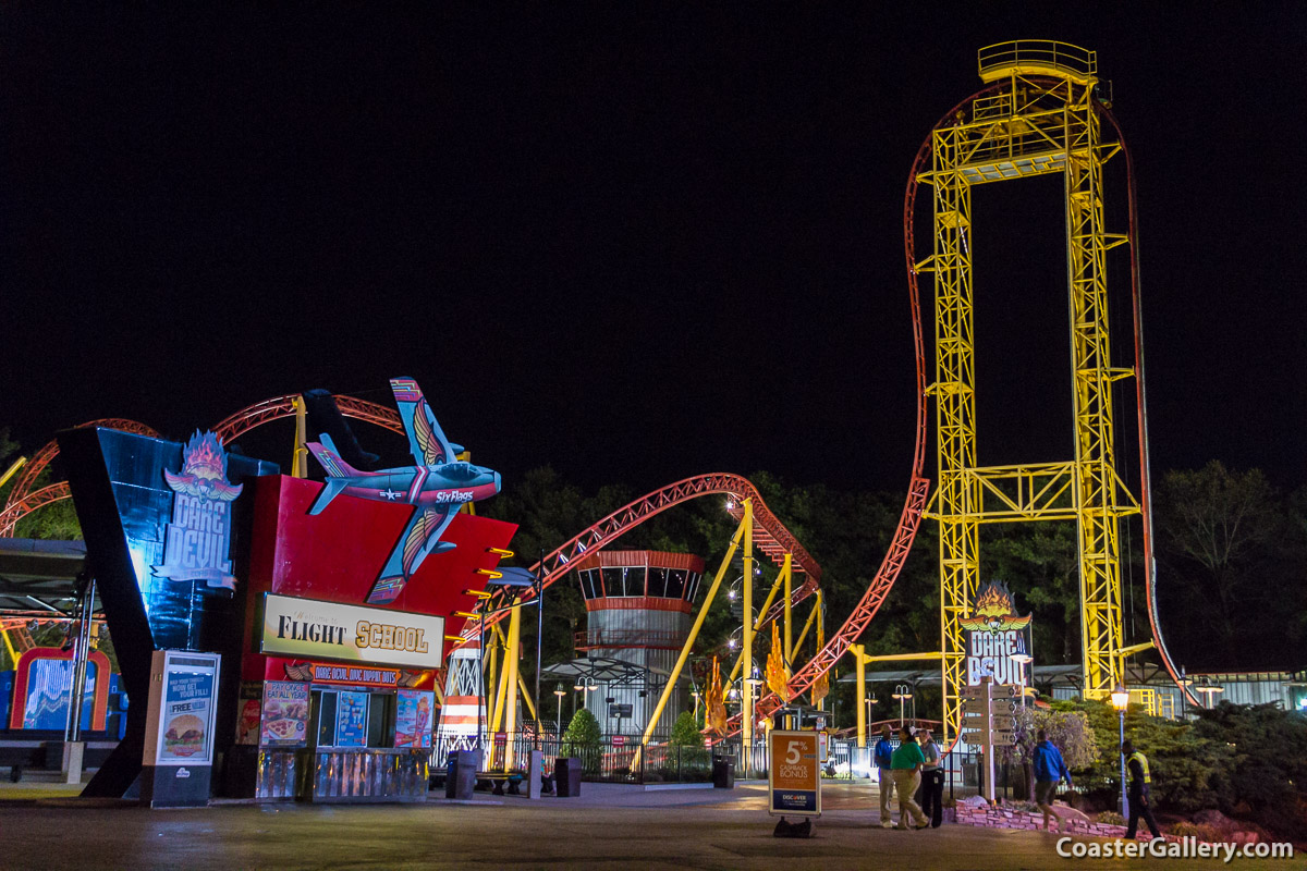A modern steel roller coaster in the darkness of night