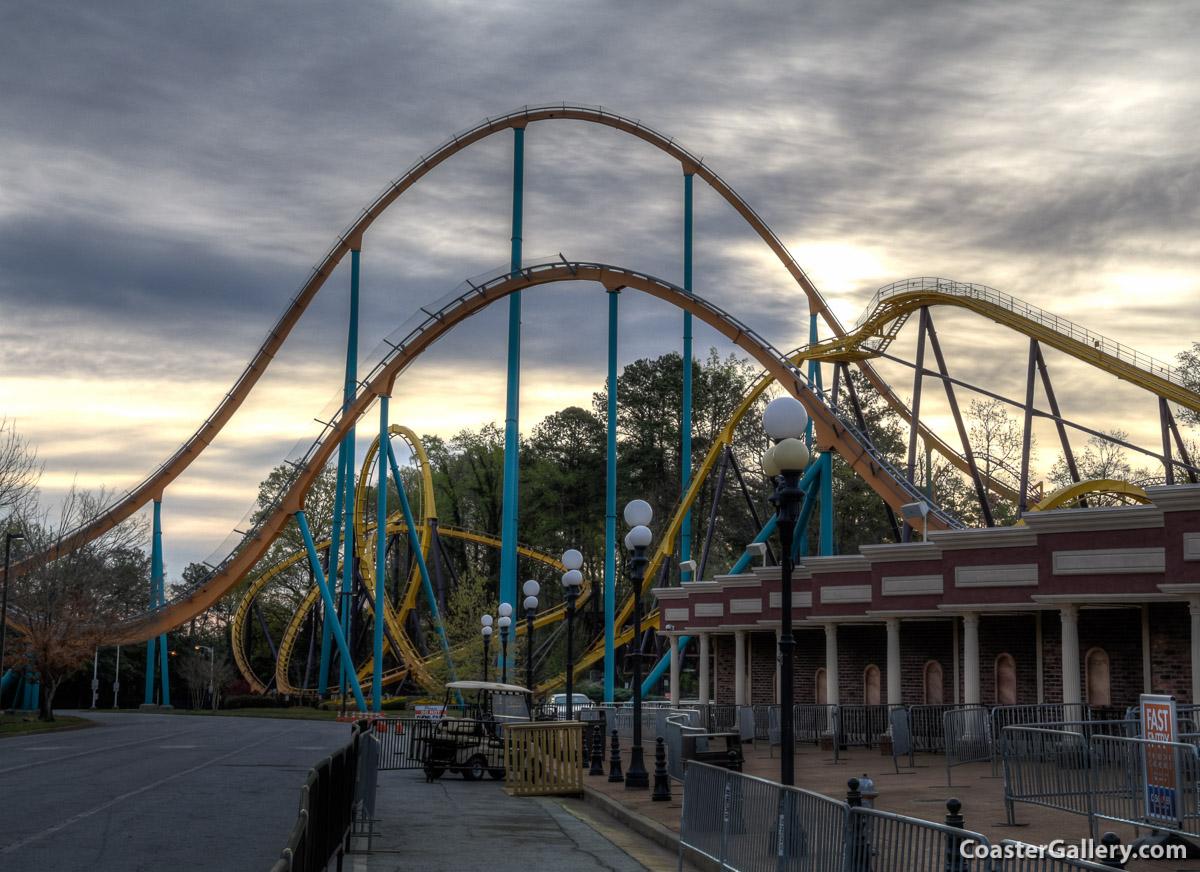Georgia Scorcher and Goliath roller coasters at sunrise